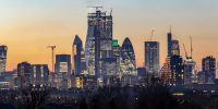 Panoramic view to the skyline of the City of London, financial district, just after sunset, United Kingdom