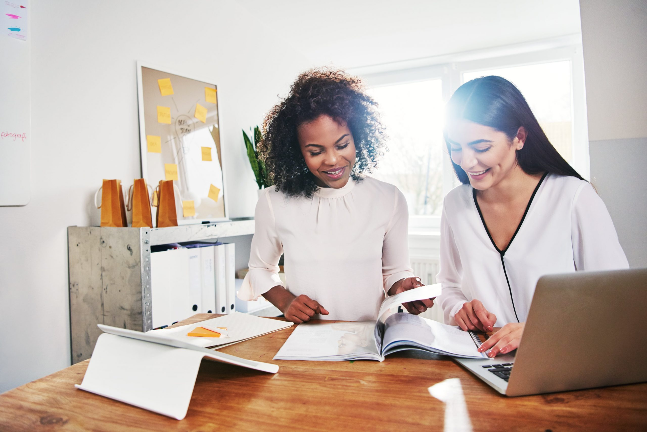 two women at a desk